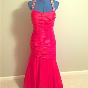 Red fitted formal gown